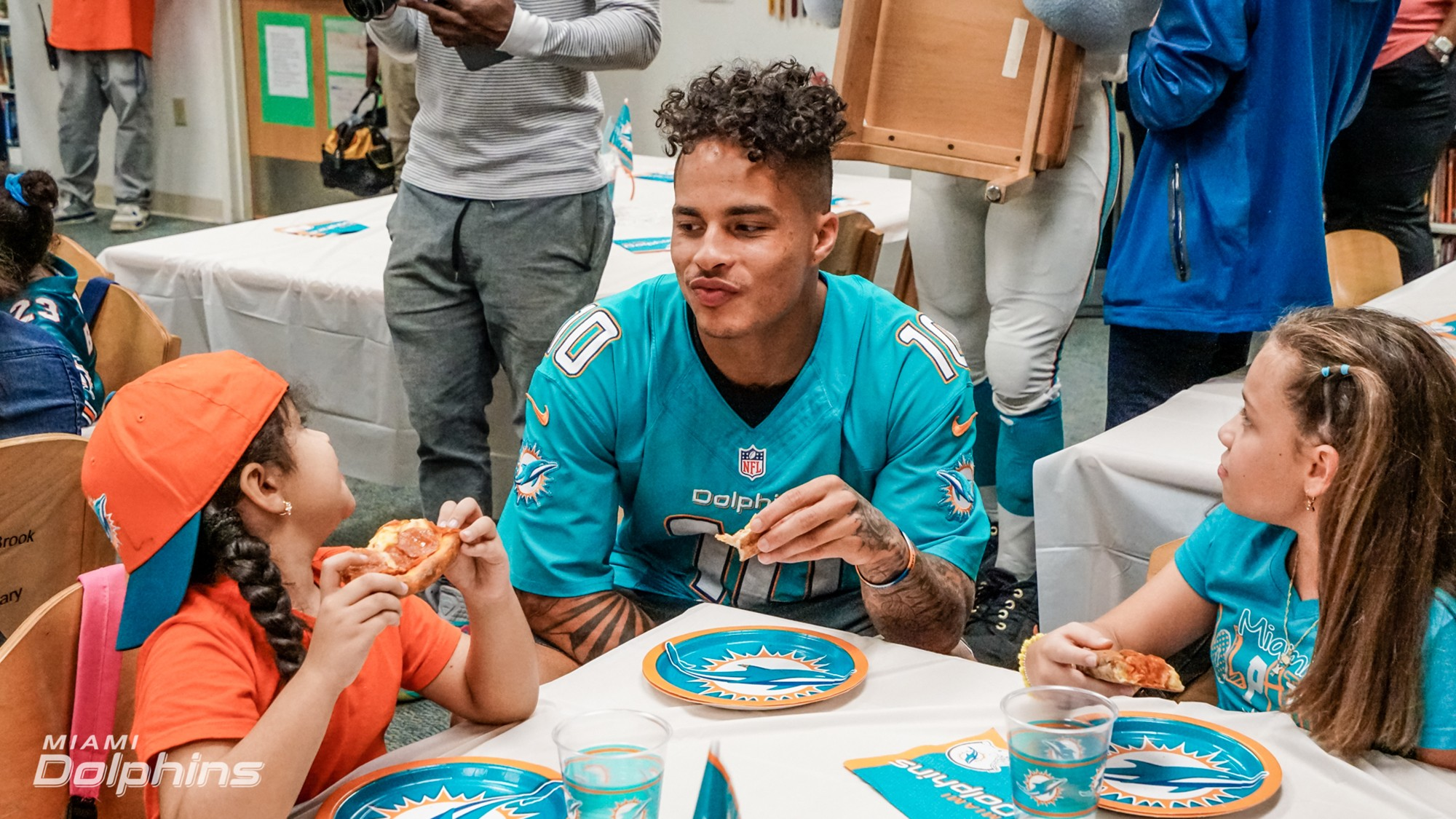 WR Kenny Stills eats lunch with students at Orange Brook elementary during Back to School Backpack Event