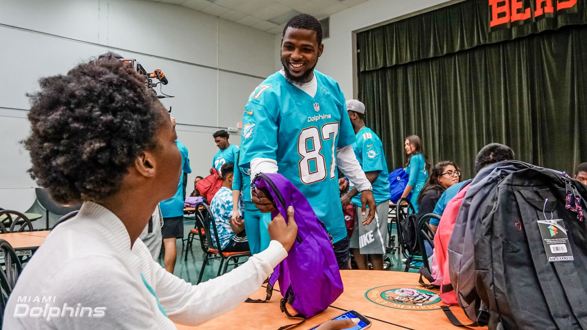 WR Rashawn Scott passes out backpacks at Back to School Backpack Event