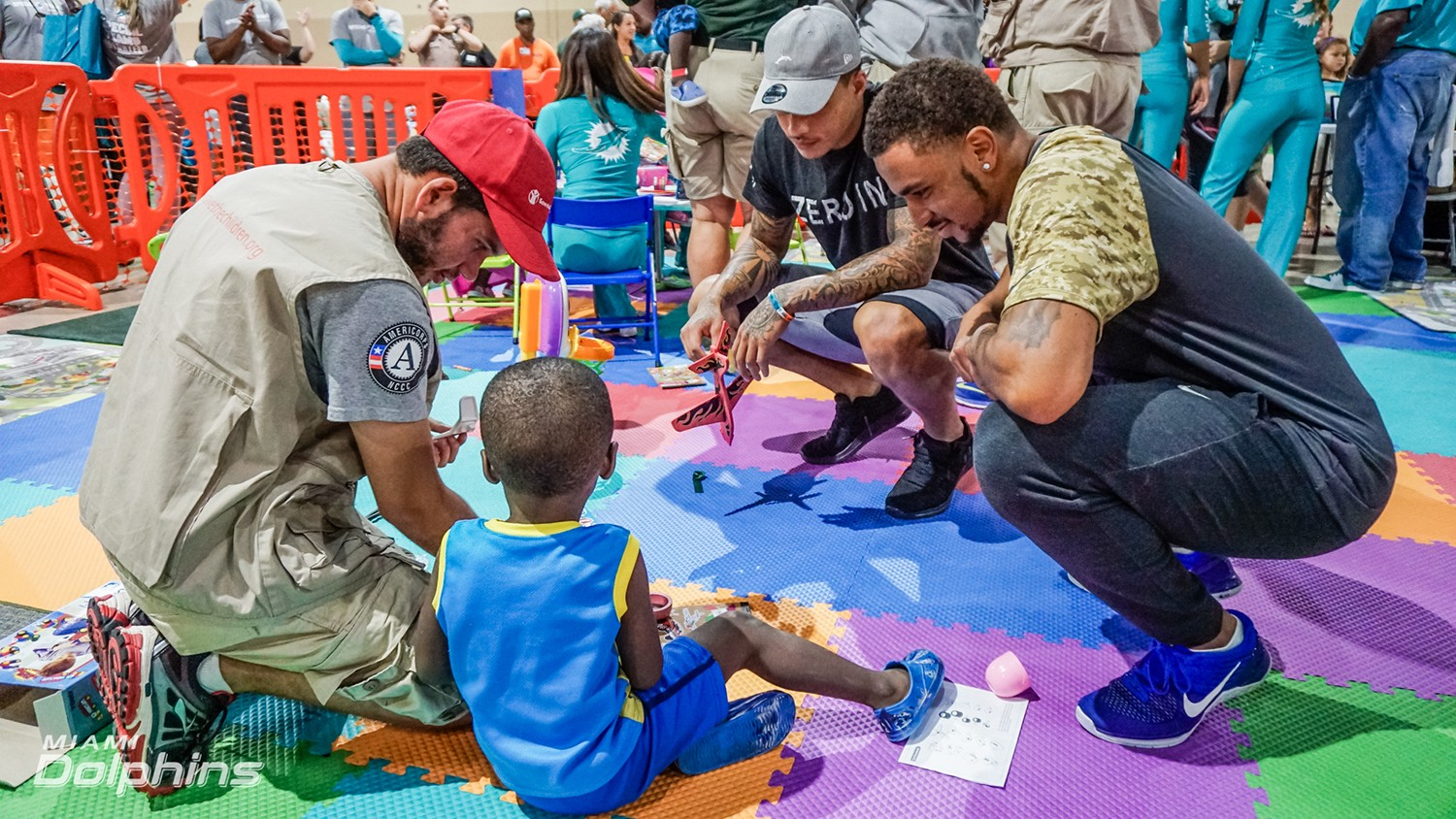 Miami Dolphins WR Kenny Stills (middle) and CB Torry McTyer (right) at Red Cross Shelter