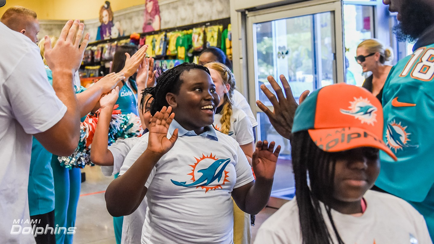 Miami Dolphins Host Hallowen Costume Shopping with Elementary School Students