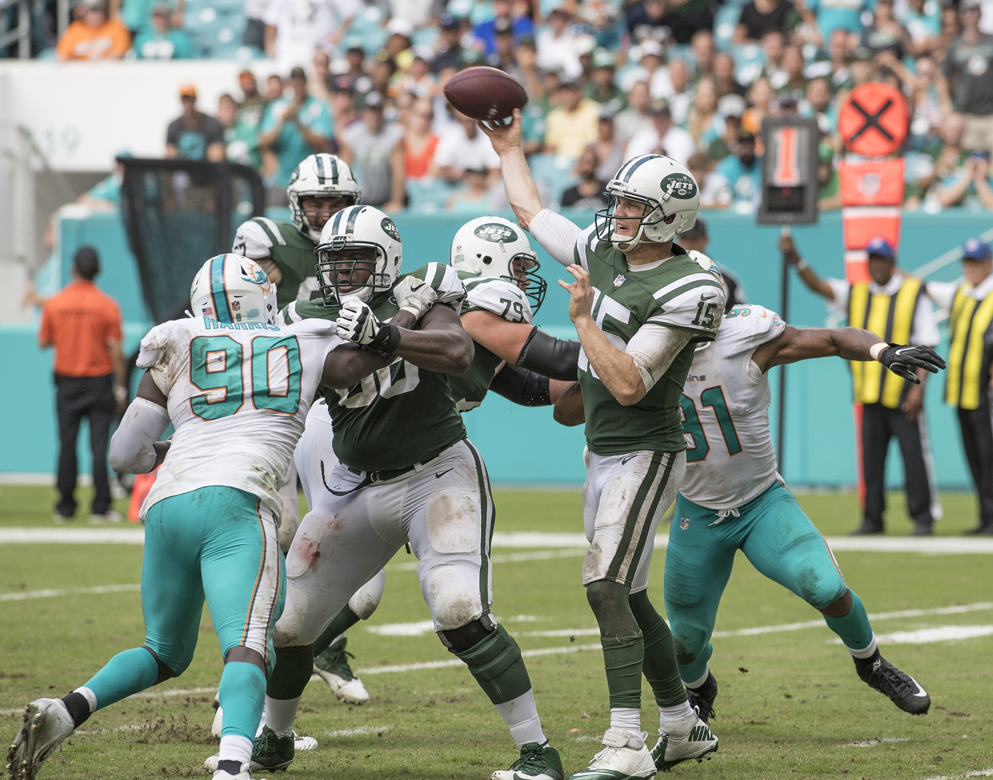 New York Jets quarterback Josh McCown (15) releases a pass that is intercepted by Miami Dolphins cornerback Bobby McCain (28) during 2nd half play of an NFL football game on Sunday, Oct. 22, 2017, in Miami Gardens, Fla. The Miami Dolphins went on to defeat the New York Jets 31-28. (Donald Edgar/El Latino Digital)
