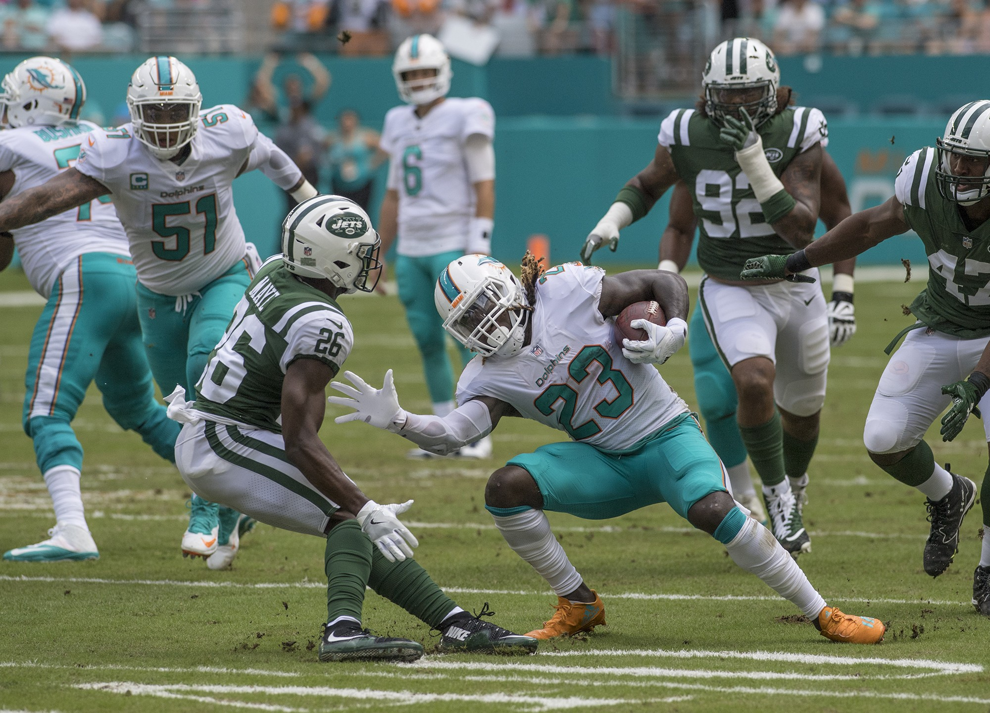 Miami Dolphins running back Jay Ajayi (23) makes a cut as New York Jets free safety Marcus Maye (26) defends the play during 1st half play of an NFL football game on Sunday, Oct. 22, 2017, in Miami Gardens, Fla. The Miami Dolphins went on to defeat the New York Jets 31-28.(Donald Edgar/El Latino Digital)