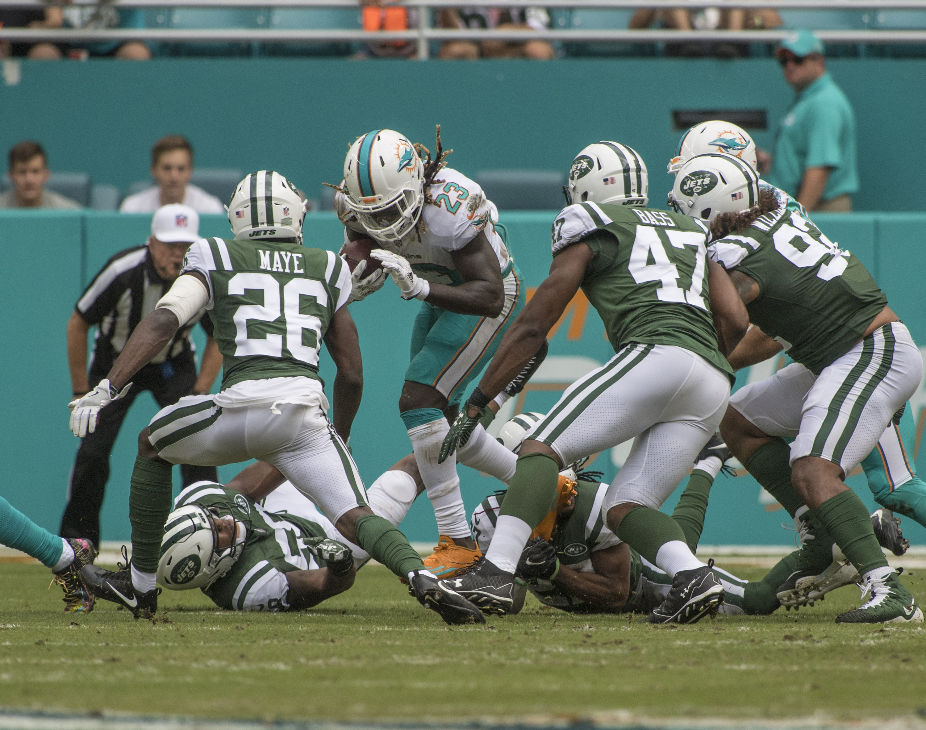 Miami Dolphins running back Jay Ajayi (23) runs the ball as New York Jets free safety Marcus Maye (26) defends during 1st half play of an NFL football game on Sunday, Oct. 22, 2017, in Miami Gardens, Fla. The Miami Dolphins went on to defeat the New York Jets 31-28. (Donald Edgar/El Latino Digital)