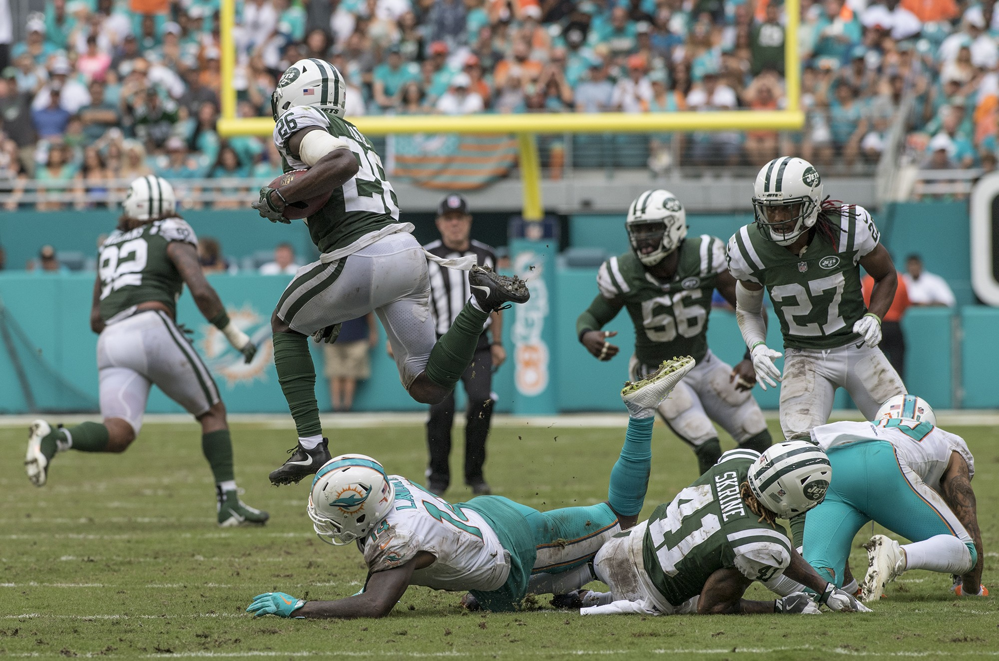 New York Jets free safety Marcus Maye (26) lisped over Miami Dolphins wide receiver Jarvis Landry (14) after an interception during 2nd half play of an NFL football game on Sunday, Oct. 22, 2017, in Miami Gardens, Fla. The Miami Dolphins went on to defeat the New York Jets 31-28. (Donald Edgar/El Latino Digital)