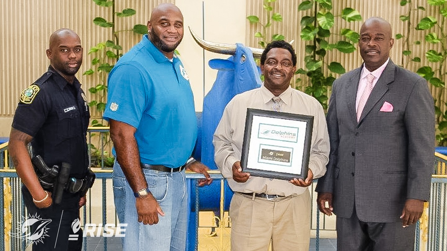 (L-R) Northwestern HS Resource Officer Antuan Rolle , Dolphins Youth Programs Manager Troy Drayton. HSCOW Max Edwards, Principle Wallace Aristide