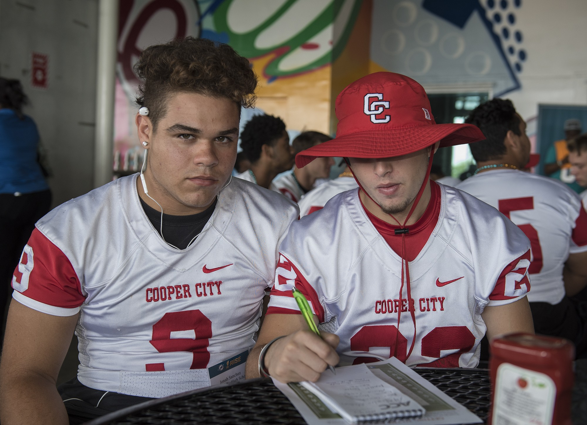 Cooper City FB Jonah Sanchez and WR Andrew Hausdorff both class of 2018 enjoy the RISE Tailgate party prior to the New Jets vs Miami Dolphins NFL football game on Sunday, Oct. 22, 2017, in Miami Gardens, Fla. (Donald Edgar/El Latino Digital)