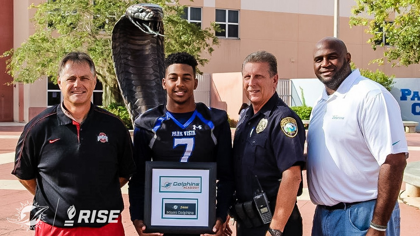 (L-R) Park Vista HS Head Coach Brian Dodds, HSPOW John Smith, Resource Officer Richard O'Connor, Dolphins Youth Programs Manager Troy Drayton